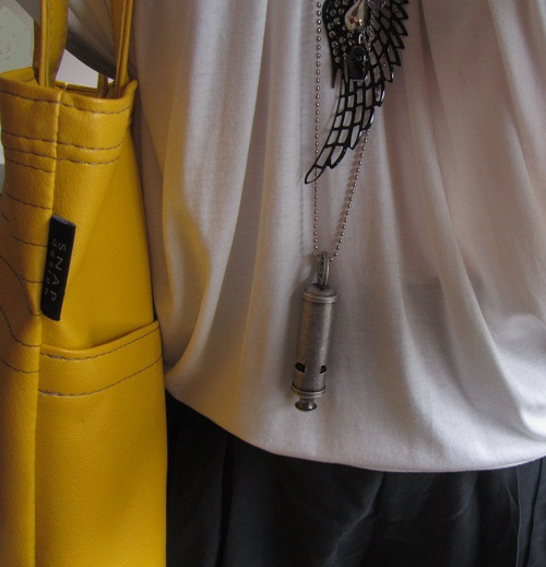 detail of tote and necklaces
