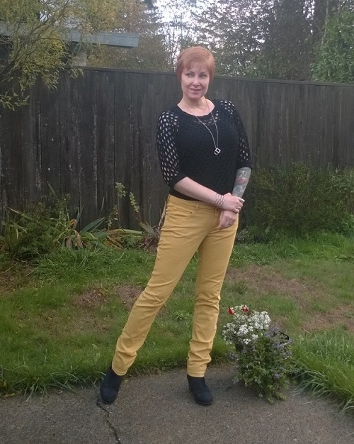 yellow jeans and faux leather shoes